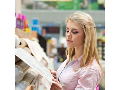 Woman shopping for paint